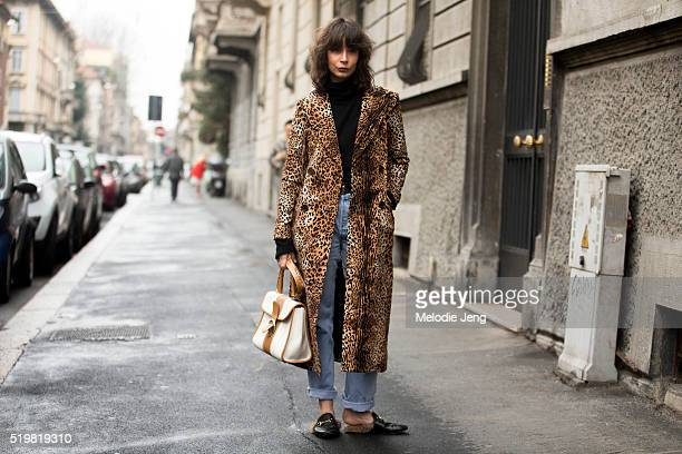 Irina Lakicevic wears leopard print trench coat a cream/tan purse and Gucci Princetown leather slipper fur loafers at the Antonio Marras show during...