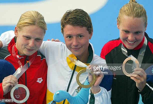 Irina Lashko of Australia celebrates winning the gold medal with silver medallist Conny Schmalfuss of Germany and bronze maedallist Blythe Harley of...