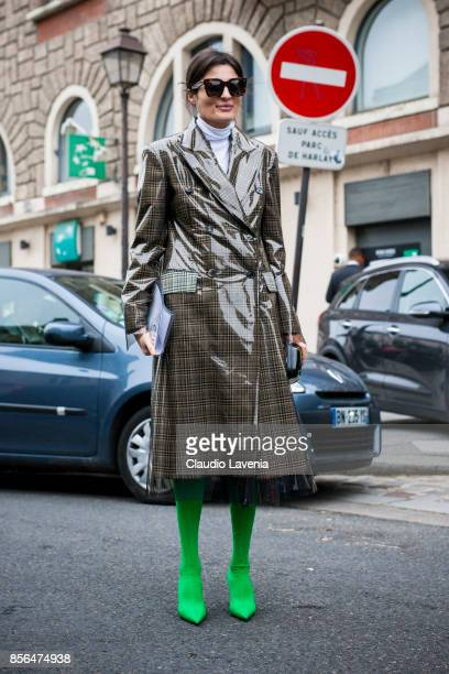 Irina Linovich is seen wearing a Calvin Klein trenchcoat and Balenciaga boots before the Givenchy show during Paris Fashion Week Womenswear SS18 on...