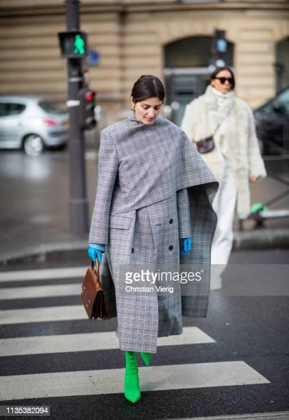 Irina Linovich is seen wearing grey coat outside Miu Miu during Paris Fashion Week Womenswear Fall/Winter 2019/2020 on March 05 2019 in Paris France