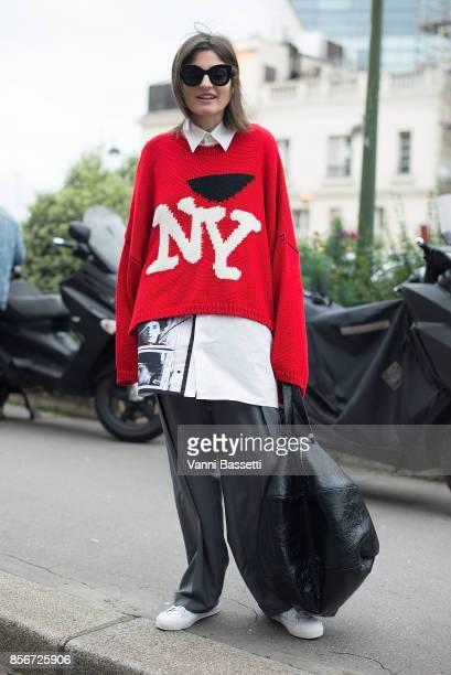 170ef88f8ab74 Irina Linovich poses before the Giambattista Valli show during Paris  Fashion Week Womenswear SS18 on October