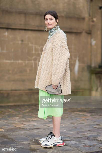 Irina Linovich poses wearing Balenciaga after the Valentino show at Les Invalides during Paris Fashion Week Womenswear FW 18/19 on March 4 2018 in...