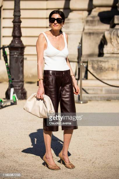 Irina Linovich wearing a cream top brown leather pants nude heels and cream bag is seen outside Giorgio Armani Prive show during Paris Fashion Week...