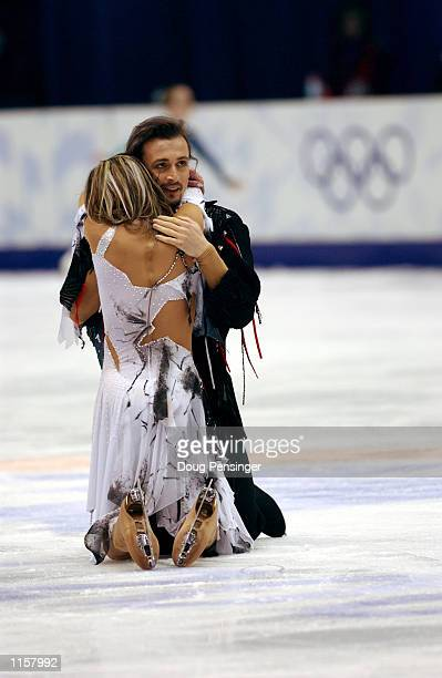 Irina Lobacheva and Ilia Averbukh of Russia embrace after their free dance on February 18, 2002 during the Salt Lake City Winter Olympic Games at the...