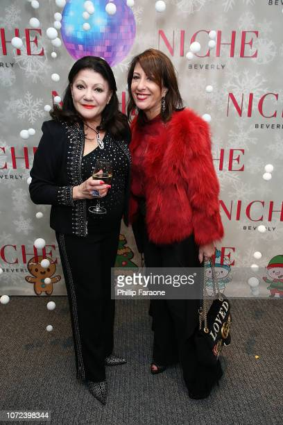 Irina Maleeva and Jamie Adler attend the Niche Beverly 2018 Holiday Party at Niche Beverly on December 12 2018 in Los Angeles California