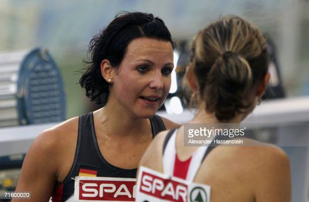 Irina Mikitenko of Germany argues with team mate Sabrina Mockenhaupt following the Women's 10000 Metres Final on day one of the 19th European...