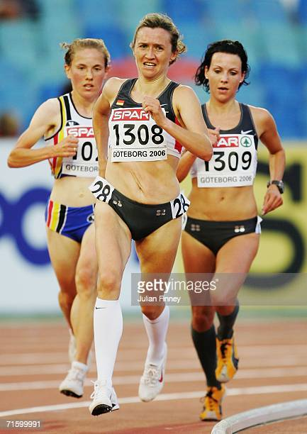 Irina Mikitenko of Germany moves ahead of team mate Sabrina Mockenhaupt of Germany during the Women's 10000 Metres Final on day one of the 19th...