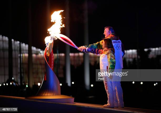 Irina Rodnina and Vladislav Tretyak light the Olympic cauldron during the opening ceremony of the 2014 Winter Olympics in Sochi Russia Friday Feb 7...