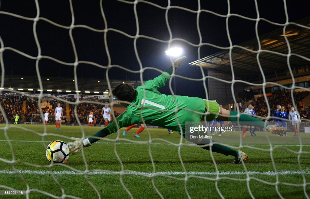Irina Sandalova of Kazakhstan fails to stop the shot from Francesca Kirby of England from the penalty spot during the FIFA Women's World Cup Qualifier between England and Kazakhstan at Weston Homes Community Stadium on November 28, 2017 in Colchester, England.
