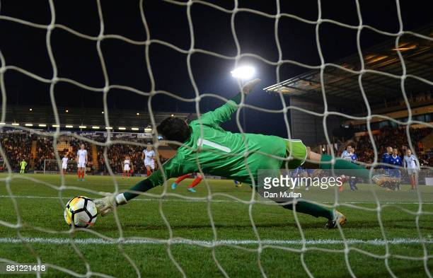 Irina Sandalova of Kazakhstan fails to stop the shot from Francesca Kirby of England from the penalty spot during the FIFA Women's World Cup...
