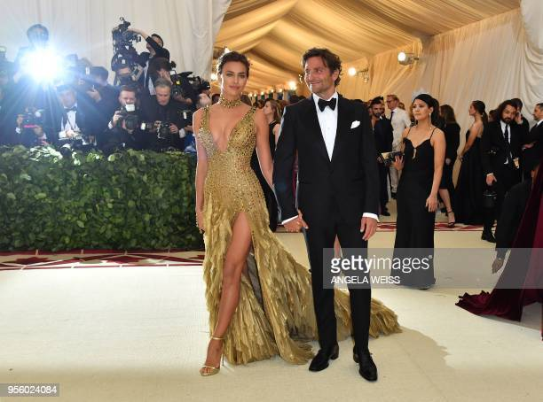 Irina Shayk and Bradley Cooper arrive for the 2018 Met Gala on May 7 at the Metropolitan Museum of Art in New York The Gala raises money for the...