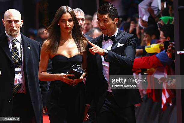 Irina Shayk and Cristiano Ronaldo of Real Madrid pose during the red carpet arrivals for the FIFA Ballon d'Or Gala 2012 on January 7 2013 at Congress...