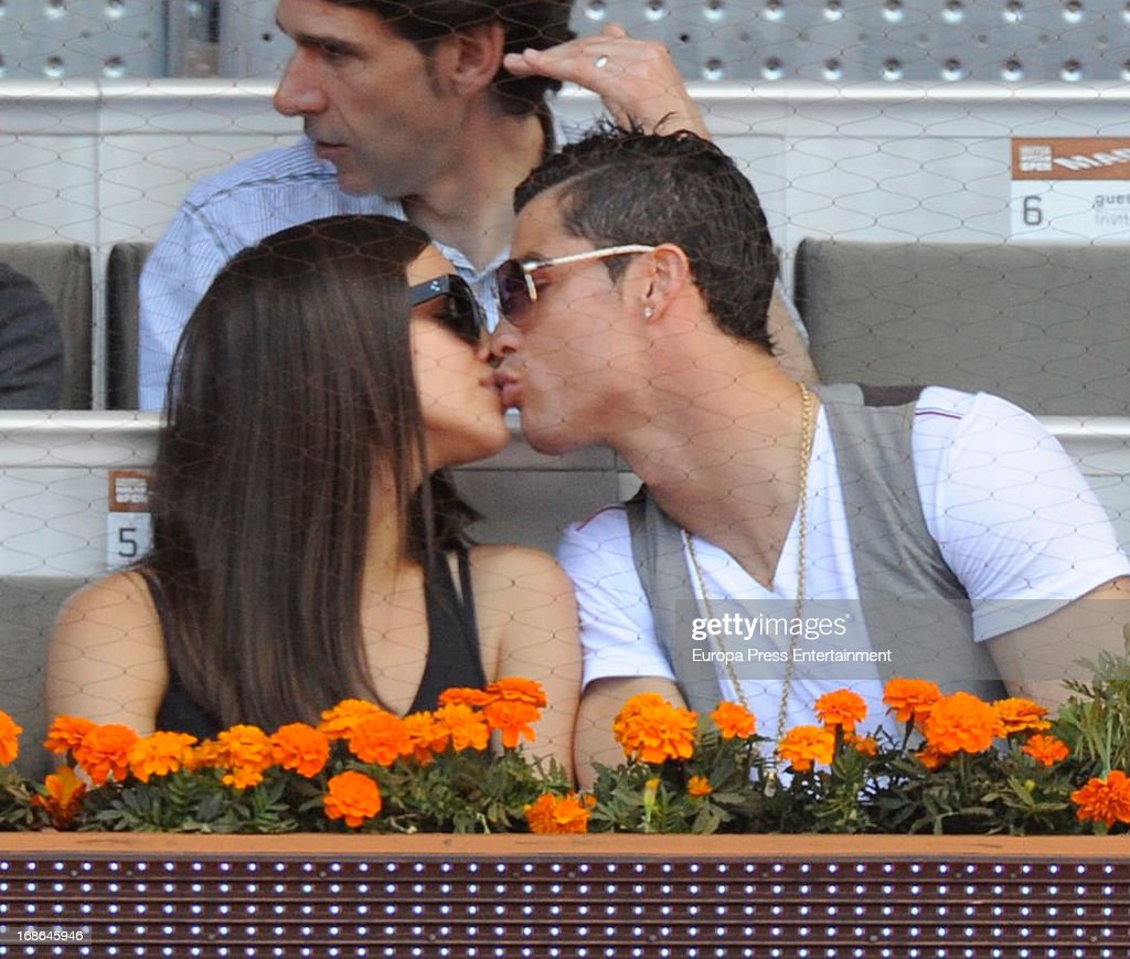 Irina Shayk and Cristiano Ronaldo share a kiss as they attend the Mutua Madrid Open tennis tournament at La Caja Magica on May 12, 2013 in Madrid, Spain.