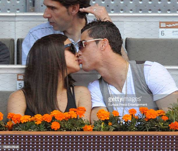 Irina Shayk and Cristiano Ronaldo share a kiss as they attend the Mutua Madrid Open tennis tournament at La Caja Magica on May 12 2013 in Madrid Spain