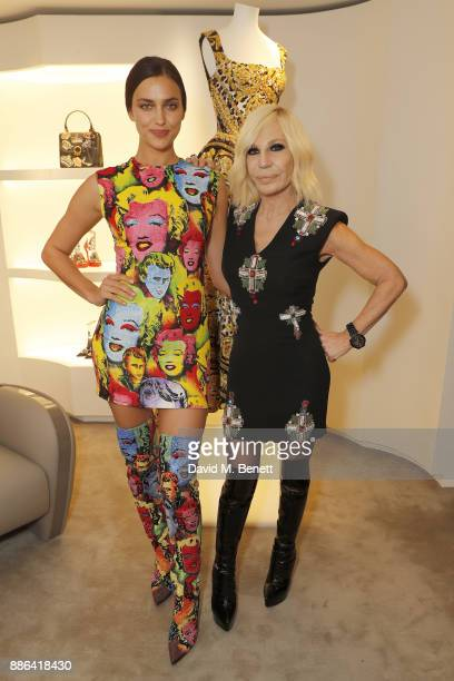 Irina Shayk and Donatella Versace attend the launch of the new Versace Sloane Street store on December 5 2017 in London England