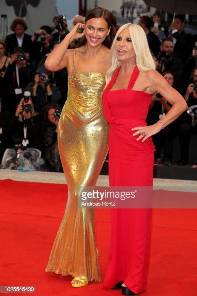 Irina Shayk and Donatella Versace walk the red carpet ahead of the 'A Star Is Born' screening during the 75th Venice Film Festival at Sala Grande on...