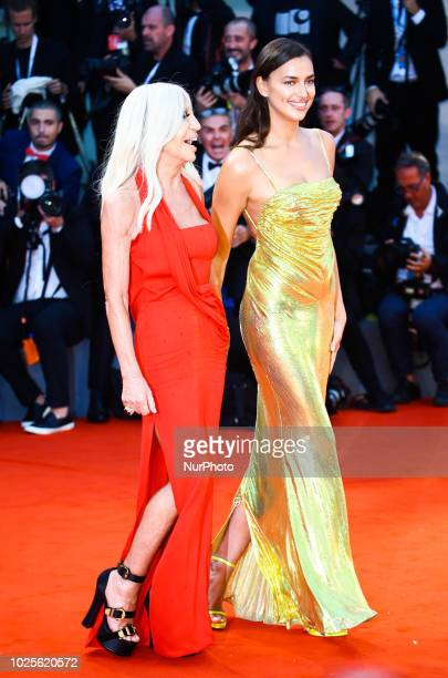 Irina Shayk and Donatella Versace walk the red carpet ahead of the 'A Star Is Born' screening during the 75th Venice Film Festival in Venice Italy on...