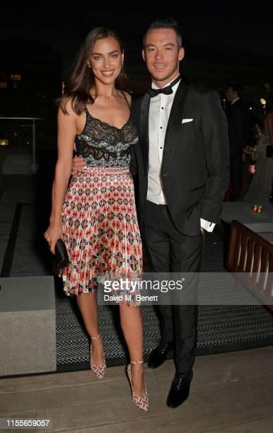 Irina Shayk and Formula E racing driver Andre Lotterer attend the 2018/19 ABB FIA Formula E Championship Awards Dinner following the Formula E 2019...