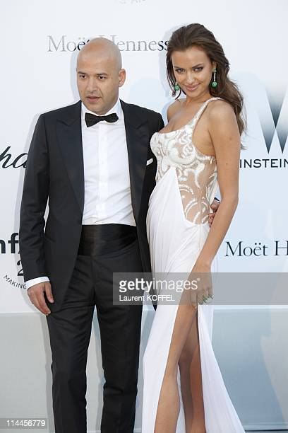Irina Shayk and guest attend amfAR's Cinema Against AIDS Gala during the 64th Annual Cannes Film Festival at Hotel Du Cap on May 19 2011 in Antibes...