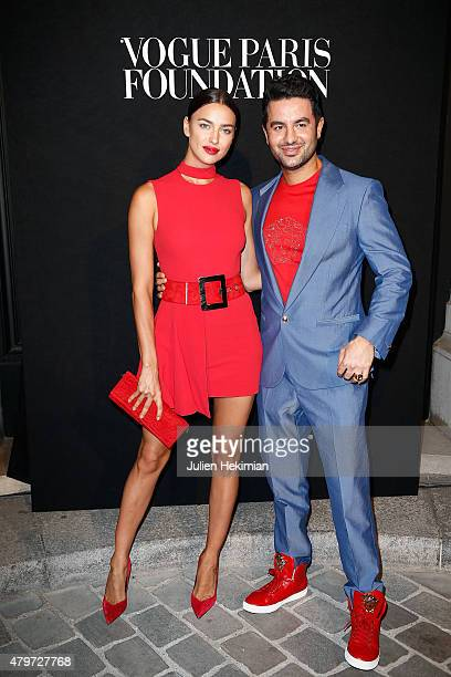 Irina Shayk and guest attend the Vogue Paris Foundation Gala at Palais Galliera on July 6 2015 in Paris France