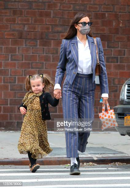 Irina Shayk and her daughter Lea Cooper are seen on May 03, 2021 in New York City.