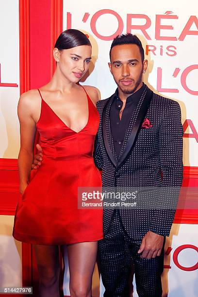 Irina Shayk and Lewis Hamilton attend the L'Oreal Red Obsession Party as part of the Paris Fashion Week Womenswear Fall/Winter 2016/2017 on March 8...