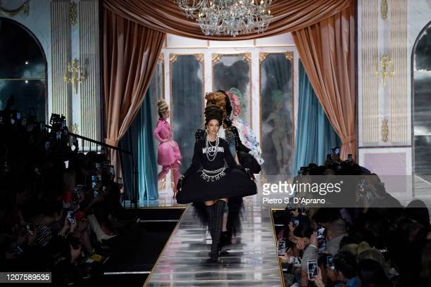 Irina Shayk and models walk the runway during the Moschino fashion show as part of Milan Fashion Week Fall/Winter 20202021 on February 20 2020 in...