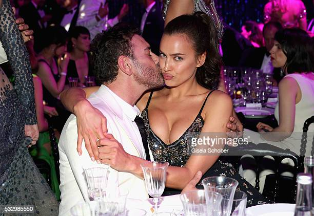 Irina Shayk and photographer Mert Alas attend the amfAR's 23rd Cinema Against AIDS Gala at Hotel du CapEdenRoc on May 19 2016 in Cap d'Antibes France