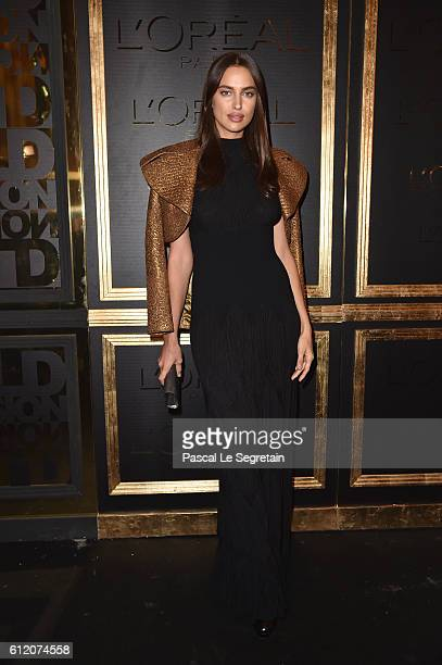 Irina Shayk attends the Gold Obsession Party L'Oreal Paris Photocall as part of the Paris Fashion Week Womenswear Spring/Summer 2017 on October 2...