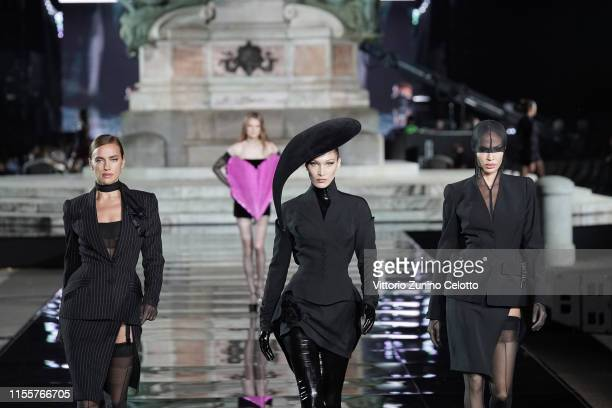 Irina Shayk, Bella Hadid and Joan Smalls walk the runway, wearing Mugler Archive, at the CR runway x LUISAVIAROMA 90th Anniversary Show during Pitti...