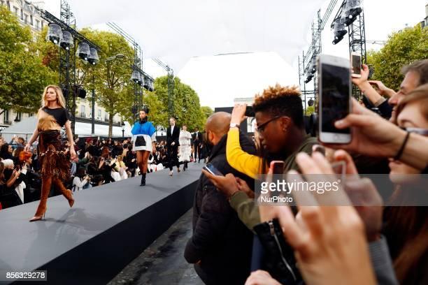 Irina Shayk Doutzen Kroes walk the runway during the Le Defile L'Oreal Paris show as part of the Paris Fashion Week Womenswear Spring/Summer 2018 at...