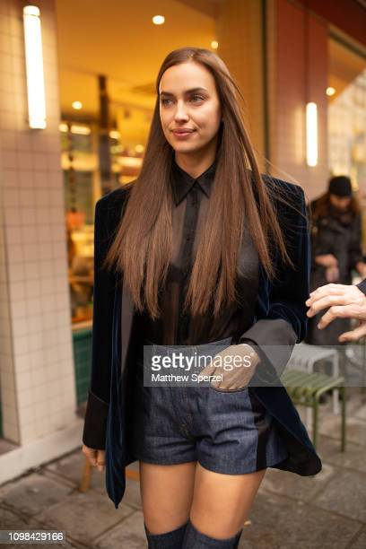 Irina Shayk is seen attending Jean Paul Gaultier during Paris Haute Couture Fashion Week wearing denim shorts with black blazer and thighhigh shoes...