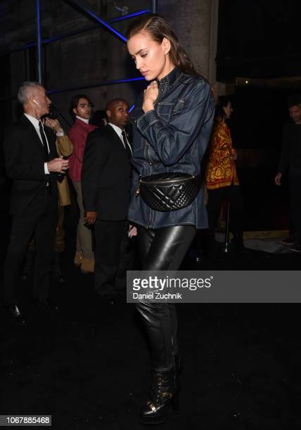 Irina Shayk is seen wearing a jean jacket and leather pants outside the Versace PreFall 2019 Collection on December 2 2018 in New York City