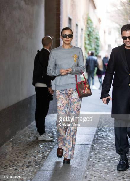 Irina Shayk is seen wearing grey jumper pants with print bucket bag outside Etro during Milan Fashion Week Fall/Winter 20202021 on February 21 2020...