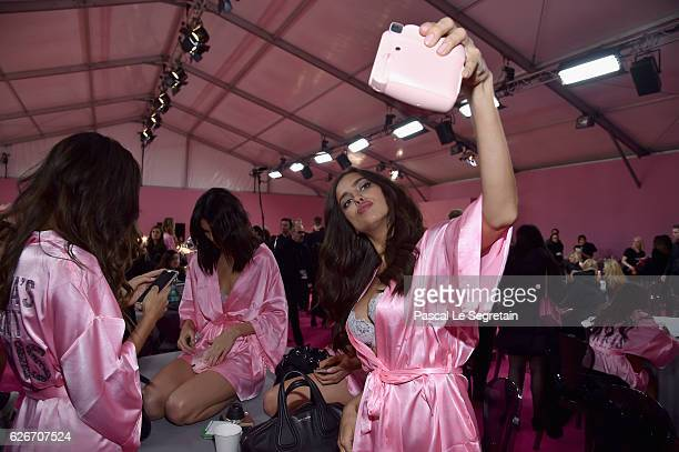 Irina Shayk poses backstage prior to the Victoria's Secret Fashion Show on November 30 2016 in Paris France