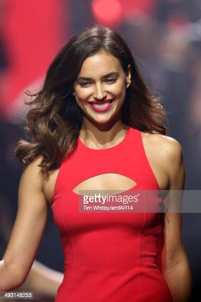 Irina Shayk walks the runway at amfAR's 21st Cinema Against AIDS Gala Presented By WORLDVIEW BOLD FILMS And BVLGARI at Hotel du CapEdenRoc on May 22...