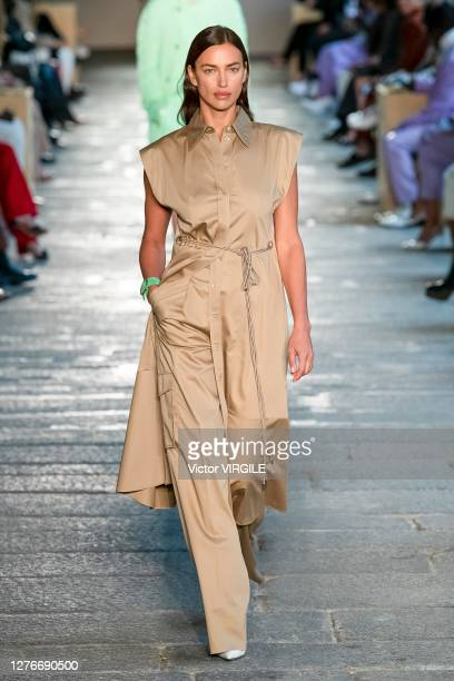 Irina Shayk walks the runway at the Boss Ready to Wear Spring/Summer 2021 fashion show during the Milan Women's Fashion Week on September 25, 2020 in...