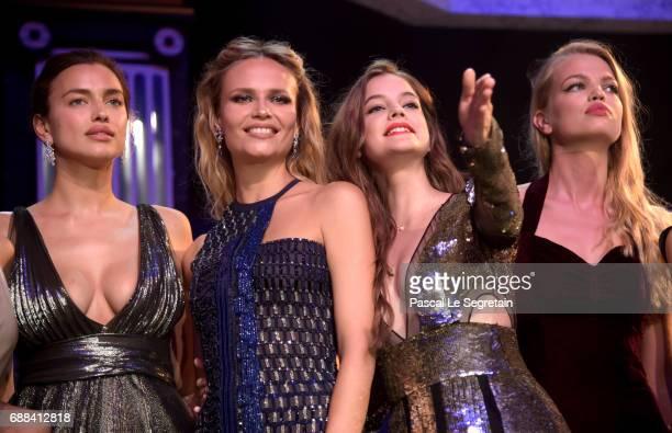 Irina Shayk wearing Dior Natasha Poly wearing Versace Barbara Palvin wearing Alexander McQueen and Daphe Groenveld wearing Stella Mcartney on stage...