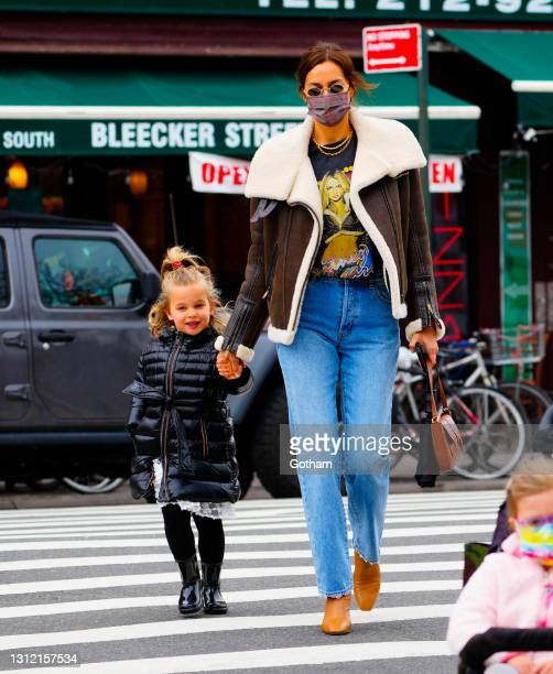 Irina Shayk wears a Britney Spears shirt underneath a shearling jacket while walking with her daughter Lea de Seine on April 12, 2021 in New York...