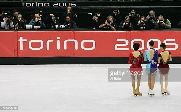 Irina Slutskaya of Russia bronze medal Shizuka Arakawa of Japan gold medal and Sasha Cohen of the United States silver medal pose for photgraphers...