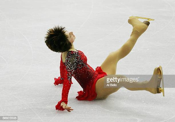 Irina Slutskaya of Russia falls in her performance during the women's Free Skating program of figure skating during Day 13 of the Turin 2006 Winter...