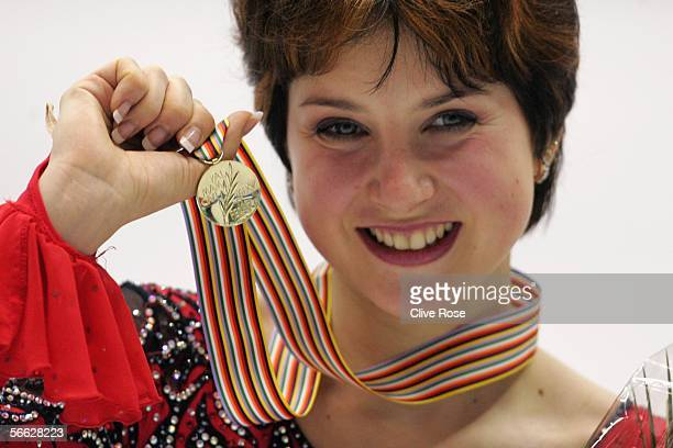 Irina Slutskaya of Russia shows off her Gold Medal after becoming seven times European Figure Skating champion at the ISU European Figure Skating...