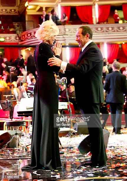 Irina Virganskaya and Paul Anka on stage after the finale of the Gorby 80 Gala at the Royal Albert Hall on March 30 2011 in London England The...