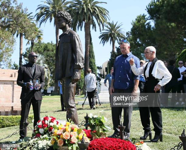 Irina Yelchin actor Anton Yelchin's mother and sculptor Nick Marra view the statue of actor Anton Yelchin at the Anton Yelchin life celebration and...