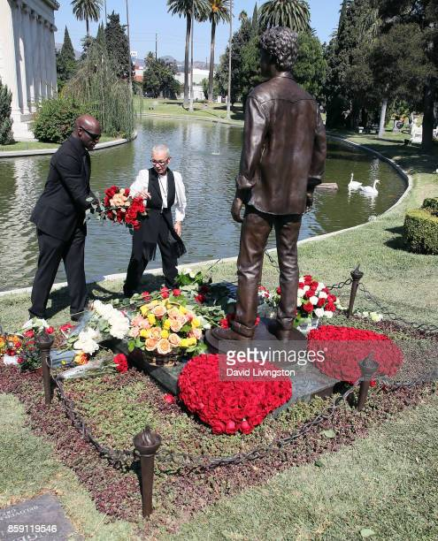 Irina Yelchin actor Anton Yelchin's mother places flowers at her son's memorial statue at the Anton Yelchin life celebration and statue unveiling...