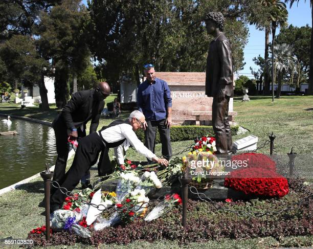 Irina Yelchin actor Anton Yelchin's mother places flowers at the foot of her son' s memorisl statue as sculptor Nick Marra looks on at the Anton...
