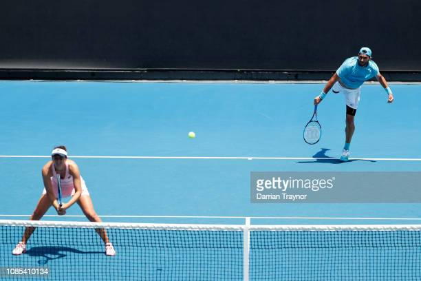 IrinaCamelia Begu and Horia Tecau of Romania compete in their first round mixed doubles against Nicole Melichar of the United States and Bruno Soares...