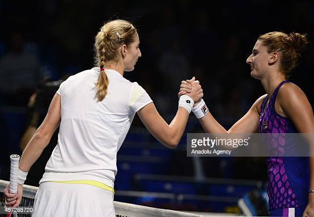 Irina-Camelia Begu of Romania and Ekaterina Makarova of Russia greet each other during their women singles tennis match on the 5th day of Kremlin Cup...