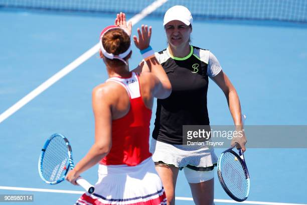 IrinaCamelia Begu of Romania and Monica Niculescu of Romania compete in their women's doubles match against Jennifer Brady of the United States and...