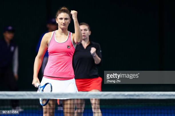 IrinaCamelia Begu of Romania and Simona Halep of Romania celebrate a point during the doubles final match against Barbora Krejcikova of Czech...